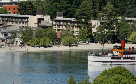 Novotel Queenstown on Queenstown Bay lakefront with TSS Earnslaw